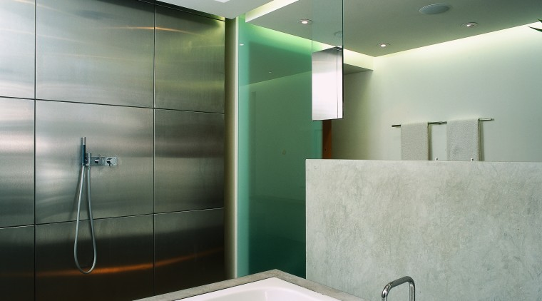 In this bathroom designed by Archis a Panosonic architecture, bathroom, bathtub, ceiling, daylighting, glass, interior design, lighting, real estate, room, wall, gray, white