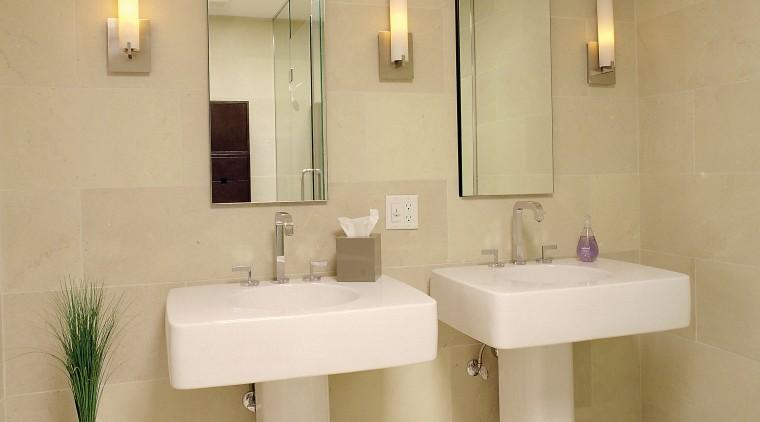 A view of this bathroom featuring dual vanities, bathroom, bathroom accessory, bathroom sink, floor, interior design, plumbing fixture, room, sink, tap, tile, orange