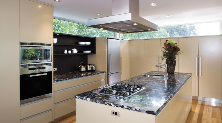 A view of this kitchen featuring polished timber countertop, interior design, kitchen, real estate, room, gray