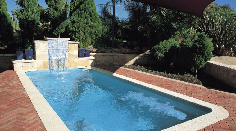 A view of a swimming pool by Aqua backyard, estate, leisure, property, real estate, swimming pool, water, water feature, black