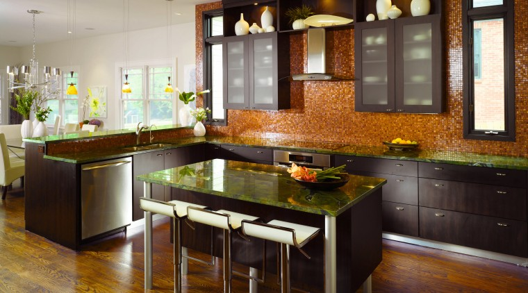 Kitchen designer Shadawn Zareh has kept the island cabinetry, countertop, cuisine classique, floor, flooring, hardwood, interior design, kitchen, room, wood flooring, brown, gray, black