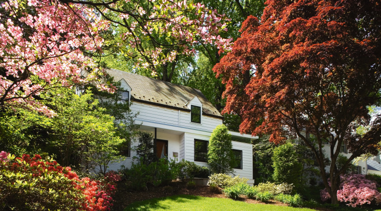 An exterior view of the home. autumn, botanical garden, cottage, estate, flower, garden, grass, home, house, landscape, landscaping, lawn, leaf, maple tree, nature, plant, plantation, property, real estate, shrub, spring, tree, brown