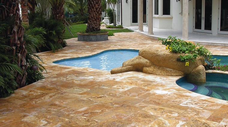 A view of Marble and travetine pavers with backyard, driveway, estate, flagstone, floor, flooring, home, landscape, landscaping, outdoor structure, patio, real estate, walkway, brown, orange