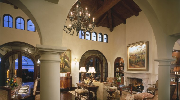 A view of the living area featuring covered arch, ceiling, estate, hacienda, home, interior design, living room, lobby, brown