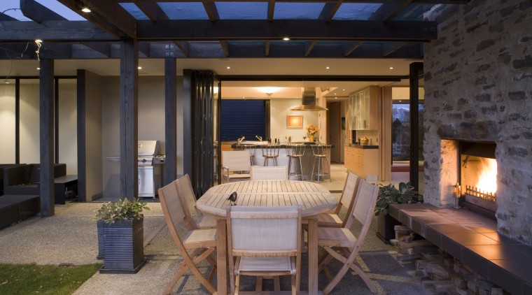 A n exposed aggregate patio, complete with river interior design, living room, patio, real estate, black
