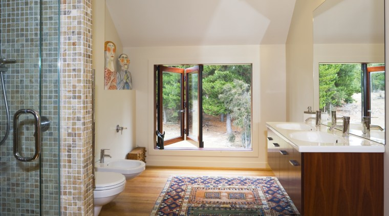 A view of the downstairs bathroom featuring toilet, architecture, bathroom, estate, floor, home, interior design, real estate, room, window, gray