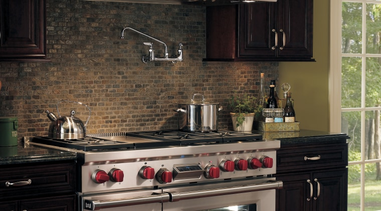 A view of some kitchen appliances from Westye cabinetry, countertop, cuisine classique, flooring, home appliance, interior design, kitchen, kitchen appliance, kitchen stove, room, under cabinet lighting, black