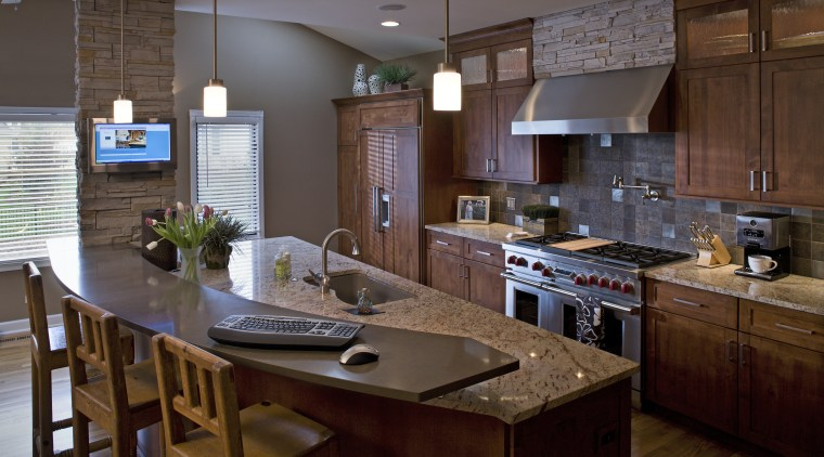 A view of a kitchen designed by Drury cabinetry, countertop, cuisine classique, interior design, kitchen, real estate, room, brown, gray