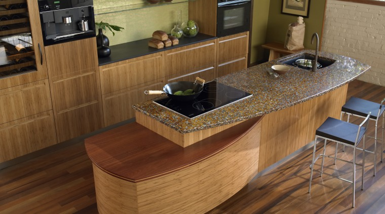 A view of this ktichen featuring a Vetrazzo cabinetry, countertop, floor, flooring, furniture, hardwood, interior design, kitchen, table, wood, wood flooring, wood stain, brown