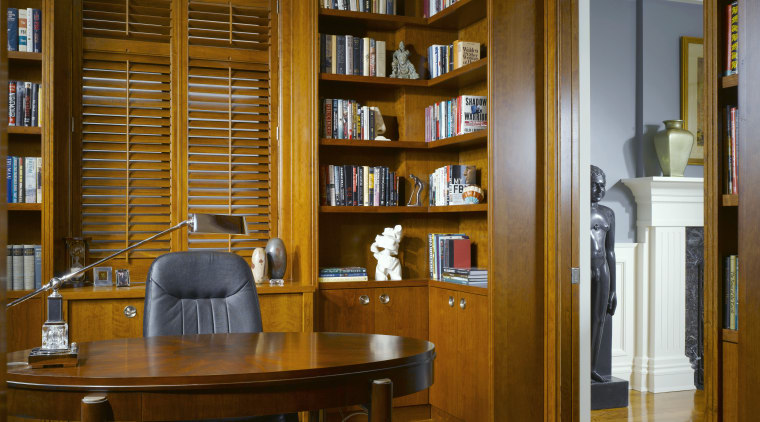 From the study, there are clear views to bookcase, furniture, institution, interior design, library, public library, shelving, brown
