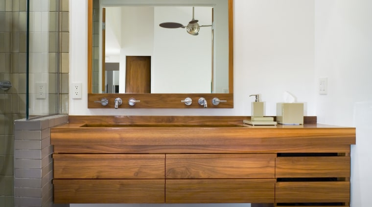 Made from American black walnut, the vanity has bathroom, bathroom cabinet, cabinetry, chest of drawers, floor, furniture, interior design, product design, room, sink, table, wall, white, gray