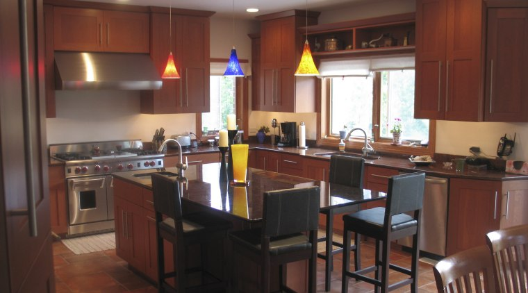 A view of this kitchen featuring a granite countertop, interior design, kitchen, room, table, red
