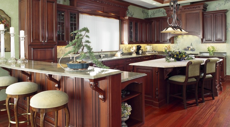 A view of a kitchen deisgned by Better cabinetry, countertop, cuisine classique, dining room, flooring, furniture, hardwood, interior design, kitchen, room, wood, wood flooring, red
