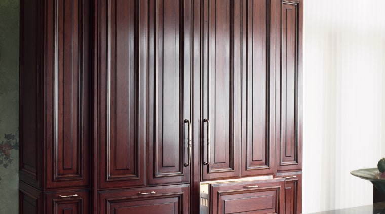 A view of a kitchen designed by Better cabinetry, chest of drawers, closet, cupboard, door, furniture, wardrobe, wood stain, red, white