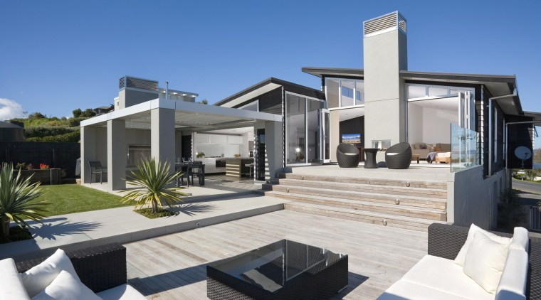 An exterior view of the outdoor living area. apartment, architecture, elevation, estate, home, house, property, real estate, villa, white