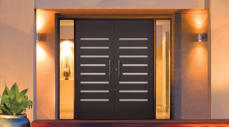 To create a grand entrance fo this contemporary door, facade, home, house, property, real estate, window, black, orange