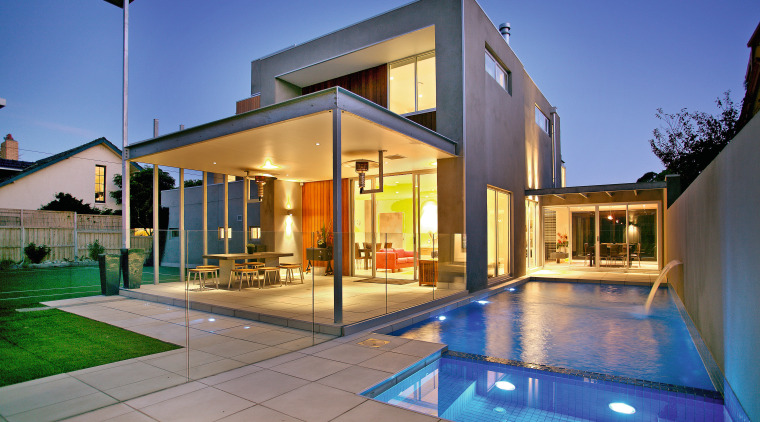 An exterior view of this contemporary family home architecture, estate, facade, home, house, lighting, property, real estate, residential area, swimming pool, villa, window, blue