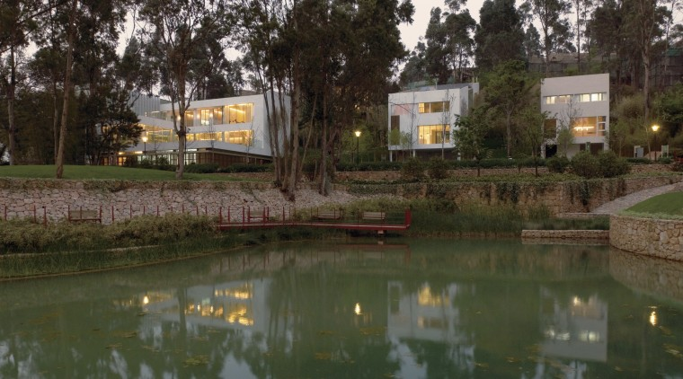 View of housing developments in the Kunming Valley. estate, home, house, landscape, plant, real estate, recreation, reflection, tree, water, waterway, brown
