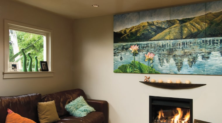 A view of these living areas feautring resene ceiling, fireplace, hearth, home, interior design, living room, wall, brown