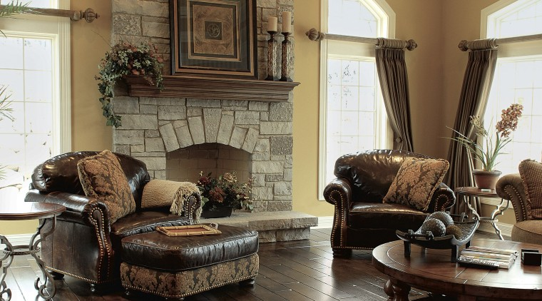 A view of these interior living areas featuring ceiling, estate, floor, flooring, furniture, hardwood, home, interior design, laminate flooring, living room, loveseat, real estate, room, wall, window, wood, wood flooring, wood stain, brown