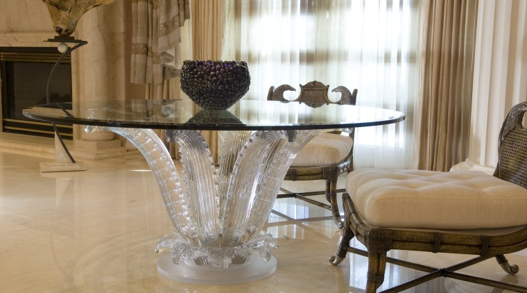 The Cactus Table is in the ballroom near chair, coffee table, dining room, floor, flooring, furniture, home, interior design, living room, room, table, brown