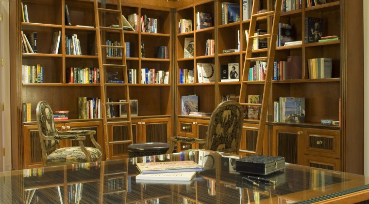 Custom Design Cabinets designed and fabricated the cabinets bookcase, bookselling, cabinetry, furniture, institution, library, library science, liquor store, public library, shelf, shelving, brown, orange