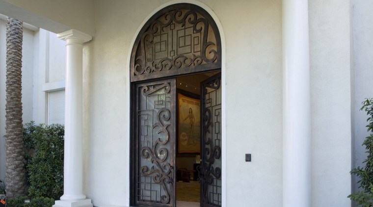 A view of the custome designed doors in arch, column, door, estate, facade, structure, window, white, gray