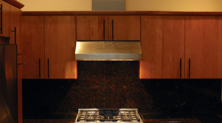 A view of some kitchen appliances from Fisher cabinetry, countertop, cuisine classique, floor, flooring, hardwood, home, home appliance, interior design, kitchen, kitchen stove, room, under cabinet lighting, wood, red