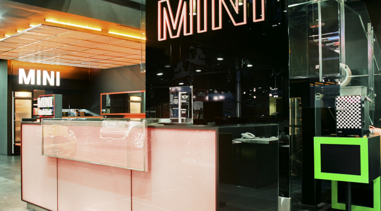 The LED-lit exterior frames are synchronised with the glass, interior design, retail, black