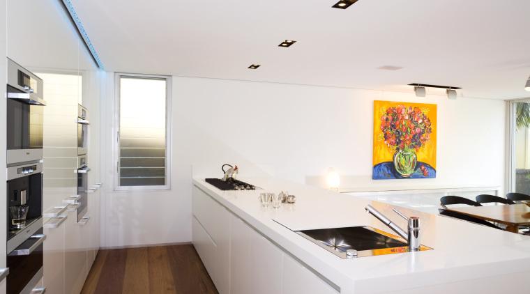 View of kitchen design by Linda Haefeli, and apartment, architecture, house, interior design, kitchen, real estate, room, white