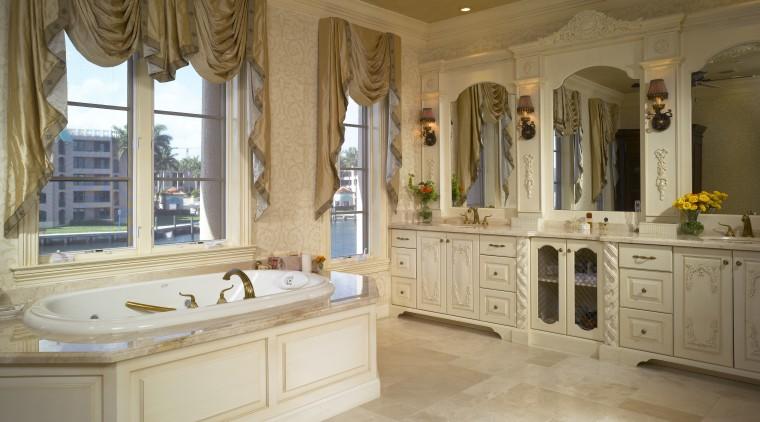 View of the master bathroom featuring a handcarved bathroom, cabinetry, ceiling, countertop, estate, floor, flooring, home, interior design, room, tile, wall, window, wood flooring, brown, orange
