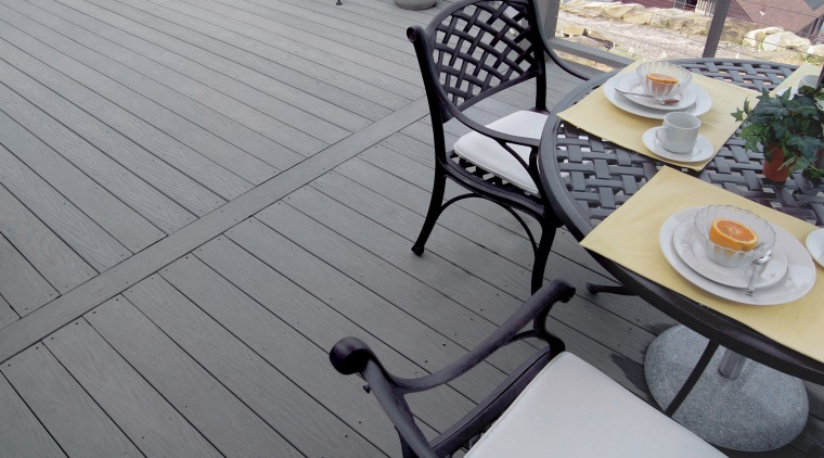 View of products from WeatherBest Decking & Railing. chair, deck, floor, furniture, outdoor furniture, outdoor structure, sunlounger, table, wood, gray