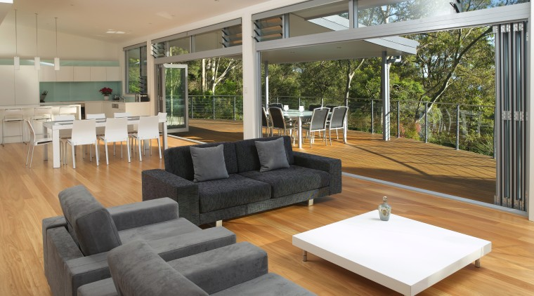 Seamlessly merging interior and exterior living spaces in architecture, daylighting, estate, floor, house, interior design, living room, property, real estate, window, gray