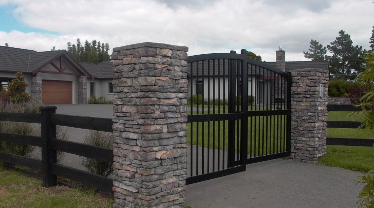 Gate with stutex stone posts estate, facade, fence, gate, home fencing, land lot, outdoor structure, property, real estate, stone wall, white