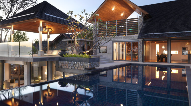 View of the outdoor area which features a estate, home, house, lighting, mixed use, property, real estate, reflection, residential area, resort, swimming pool, blue