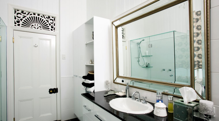 A granite-topped vanity provides generous storage, while mirrors bathroom, home, interior design, room, white, gray
