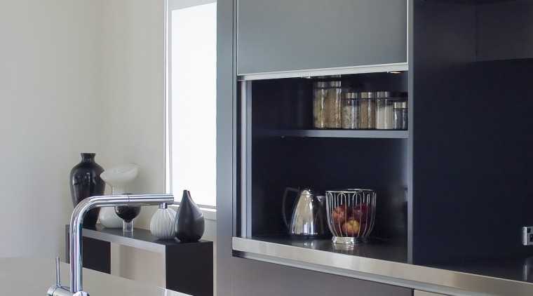 Designer Robyn Labb used a simple material palette countertop, floor, furniture, interior design, kitchen, product design, shelf, shelving, gray