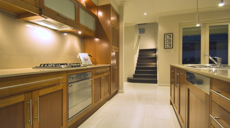Timber cabinetry brings visual warmth to the open-plan cabinetry, countertop, cuisine classique, home, interior design, kitchen, real estate, room, wood, brown, orange