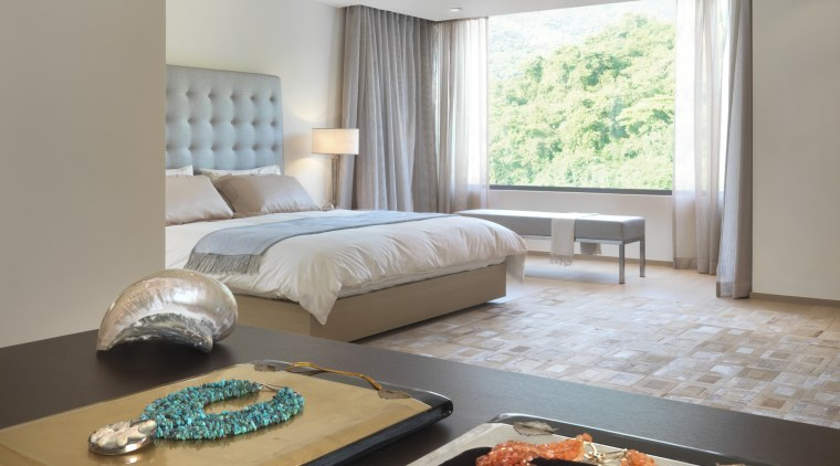 View of bedroom featuring bedroom furnishings, linen, window ceiling, home, interior design, living room, room, table, gray