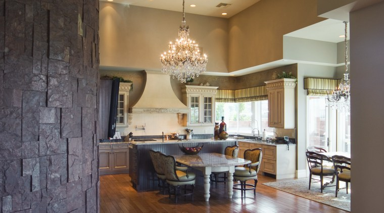 The kitchen also features a wood floor, fluted ceiling, floor, flooring, hardwood, home, interior design, laminate flooring, living room, lobby, loft, real estate, room, wall, wood, wood flooring, brown
