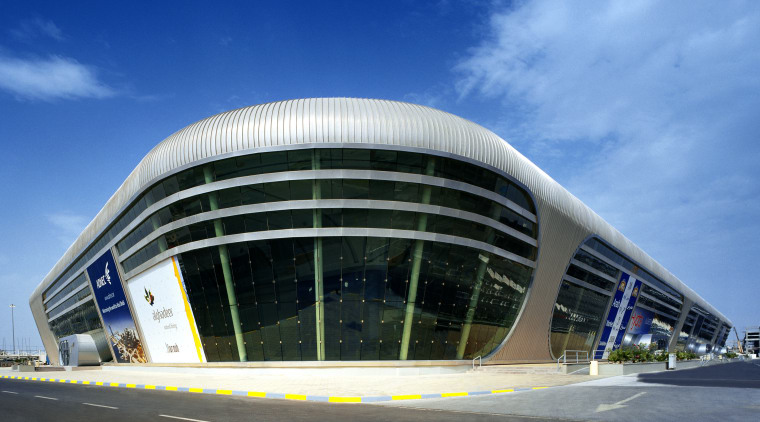Ovoid forms and futuristic styling define the exhibition architecture, building, commercial building, convention center, corporate headquarters, daytime, facade, headquarters, metropolis, metropolitan area, sky, structure, teal