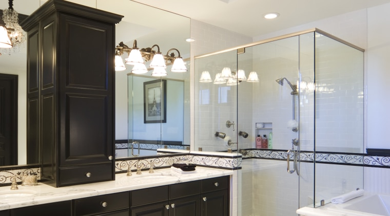This bathroom features dark-stained wood cabinetry, which enhances bathroom, ceiling, home, interior design, room, white, black