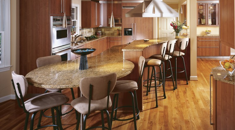 This kitchen, designed by CSI Kitchen & Bath, cabinetry, countertop, dining room, floor, flooring, hardwood, interior design, kitchen, laminate flooring, room, wood, wood flooring, brown