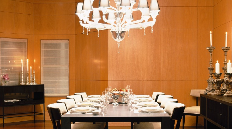 image of the main dining room which features ceiling, chandelier, dining room, furniture, interior design, light fixture, lighting, restaurant, room, table, wall, brown