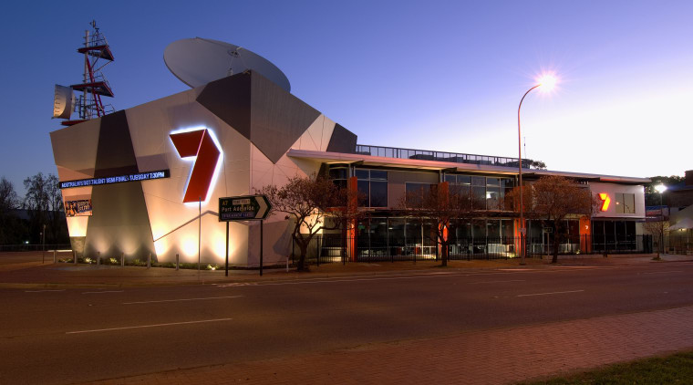 The Channel Seven studio and offices compenstae for architecture, building, city, downtown, dusk, evening, lighting, night, residential area, sky, structure, red, blue