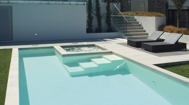 The simple,clean lines of this pool echo the architecture, estate, house, leisure, property, real estate, sky, swimming pool, water, teal