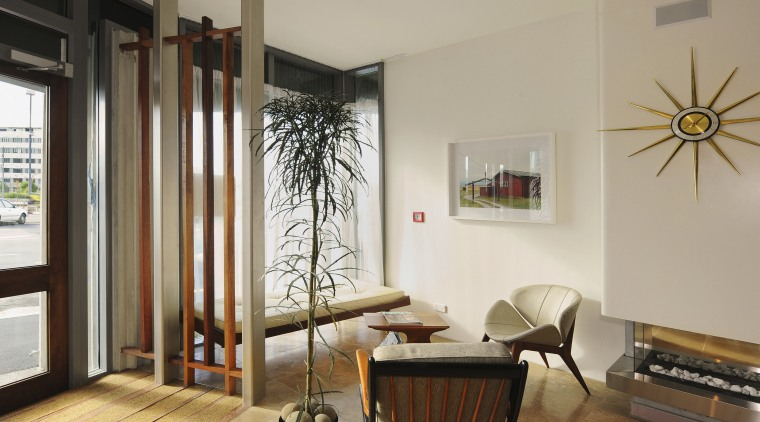 Inside, Scandinavian-inspired furniture creates a warm and comfortable ceiling, door, floor, flooring, hardwood, home, interior design, living room, real estate, room, window, wood, gray, brown