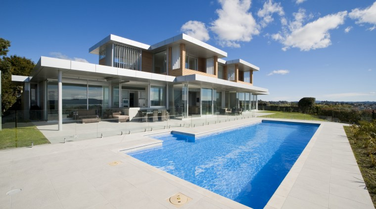 Extending almost the length of the house, the architecture, estate, facade, home, house, mansion, property, real estate, residential area, sky, swimming pool, villa, white