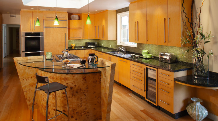 The focal point of this kitchen is the cabinetry, countertop, cuisine classique, floor, flooring, hardwood, interior design, kitchen, real estate, room, wood flooring, brown, orange