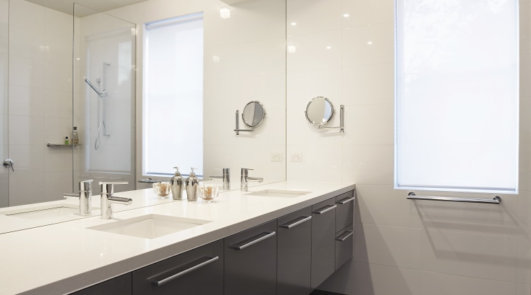 Bathrooms are designed in cool neutrals, with dark architecture, bathroom, ceiling, countertop, daylighting, floor, home, interior design, real estate, room, sink, tile, white